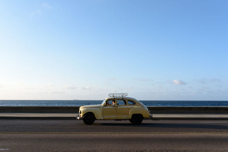 Beach Blue Car Clear Sky Day Horizon Over Water Land Vehicle Nature No People Outdoors Road Sand Scenics Sea Sky Sunlight Transportation Water