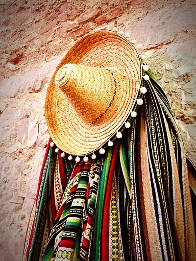 High angle view of hat hanging at market