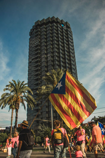 Barcelona, Spain - 09.11.2018 National day of Catalunya (Diada de Cataluña) Barcelona Catalunya SPAIN Adult Architecture Building Exterior Built Structure City Crowd España Flag Flags Group Of People Large Group Of People Lifestyles Men Nature Office Building Exterior Palm Tree Patriotism Sky Skyscraper Tall - High Women