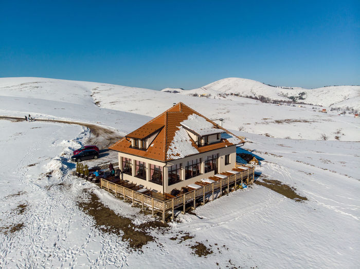 Snow Winter Cold Temperature Mountain Architecture Nature Built Structure Building Exterior Sky Scenics - Nature Day Building No People House Clear Sky Beauty In Nature Water Tranquility Environment Outdoors Snowcapped Mountain