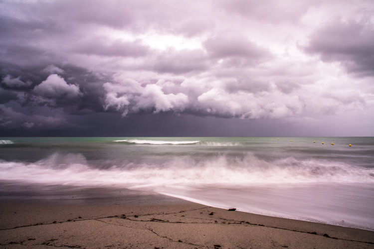 Cloud - Sky Water Sky Sea Beach Beauty In Nature Land Scenics - Nature Horizon Nature Horizon Over Water Storm No People Tranquility Sand Motion Tranquil Scene Overcast Outdoors Power In Nature Ominous