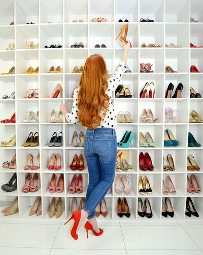 Woman standing in shelf