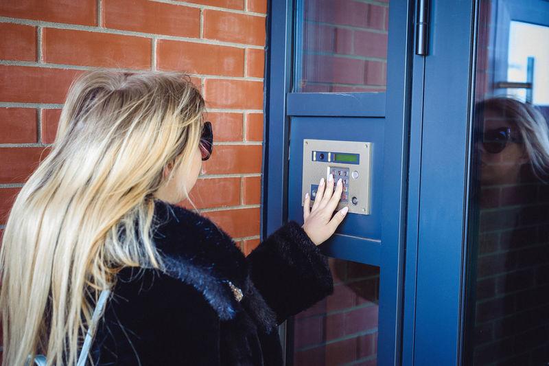 Young woman using vending machine