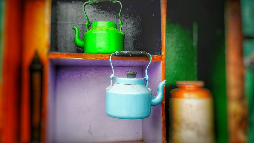 Selective Focus Green Color Shelf Fragility Focus On Foreground New Life Vibrant Colorteapot Non-urban Scene No People Multi Colored Red Color Watering Can Colorful Tea Tea Time Teatime☕️ Teapot Photography Teapots Teapot Shot