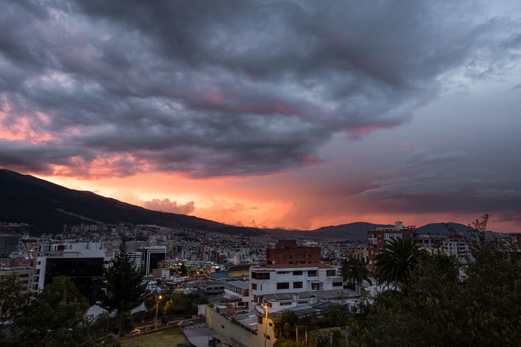 Sunset during summer with stormy clouds in Quito, Ecuador. Latin America Architecture Building Building Exterior Built Structure City Cityscape Cloud - Sky Dramatic Sky Environment Extreme Weather Mountain Nature No People Ominous Outdoors Plant Power In Nature Residential District Sky Storm Storm Cloud Thunderstorm Tree Urban Skyline