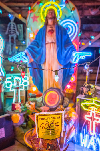 Neon signs and decorations at God's Own Junkyard in Walthamstow, London. Bright Christmas Colors Colourful Jesus Neon Signs Parking Ticket City Lighting Communication Human Representation Illuminated Multi Colored Neon Neon Lights Parking Fine  Religion Religious  Spirituality Text Ticket Urban Urban Lighting