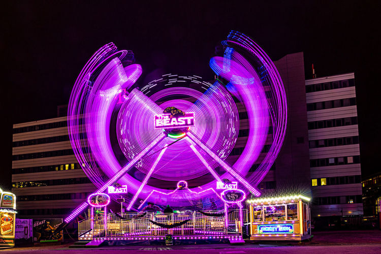 Night Illuminated Amusement Park Ride Amusement Park Ferris Wheel Spinning Motion Glowing Long Exposure Speed No People Multi Colored City Outdoors Fairground Blurred Motion Arts Culture And Entertainment
