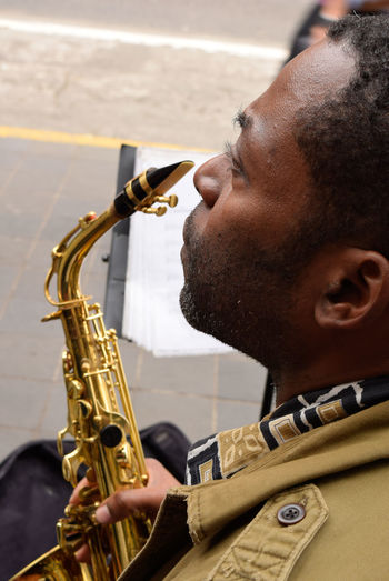 Arts Culture And Entertainment Close-up Cropped Day Focus On Foreground Lifestyles Machinery Man Musical Equipment Musical Instrument Musical Instrument String Part Of Portrait Sax Saxophone Saxophonist Skill  Street Portrait Streetphotography Up Close Street Photography The Portraitist - 2016 EyeEm Awards 43 Golden Moments