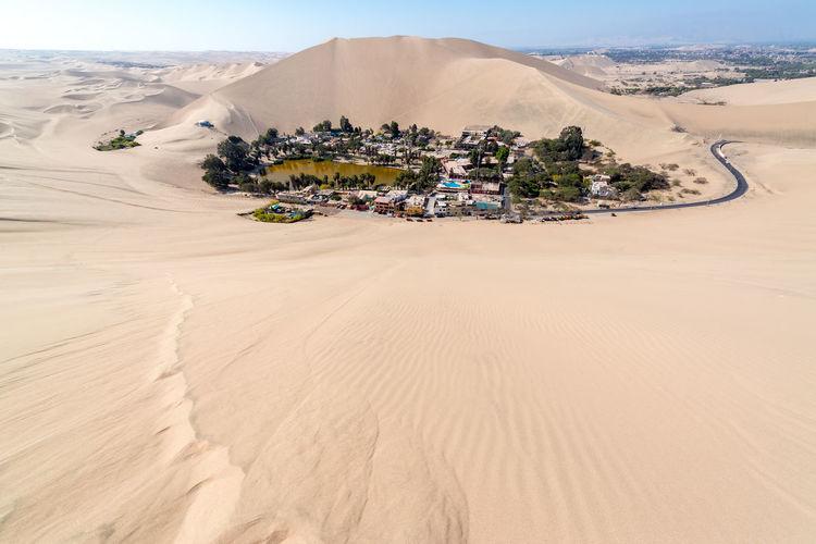 Huacachina against sand dune