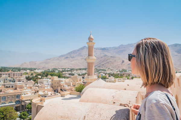 Ancient Ancient Civilization Archaeology Architecture Built Structure Clear Sky History Lifestyles Mountain Mountain Range Nizwa Fort Old Ruin Oman One Person Outdoors Real People Rear View Sky Tourism Travel Travel Travel Destinations Travel Photography Women Young Adult
