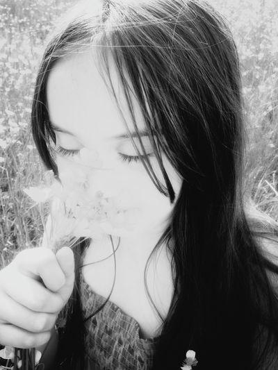 Close-up portrait of woman holding cigarette