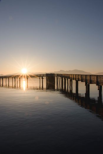 Water Sky Sea Sunset Tranquility Tranquil Scene Scenics - Nature Beauty In Nature No People Clear Sky Architecture Nature Built Structure Waterfront Copy Space Pier Sunlight Sun Outdoors Reflection