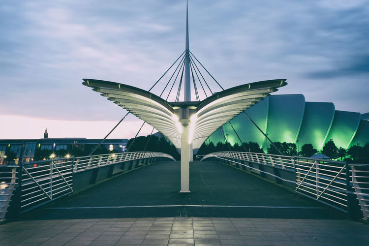 Low angle view of footbridge against sky