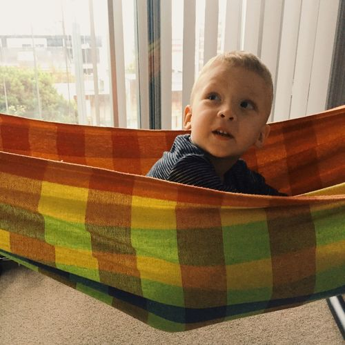 Boy Relaxing In Hammock At Home