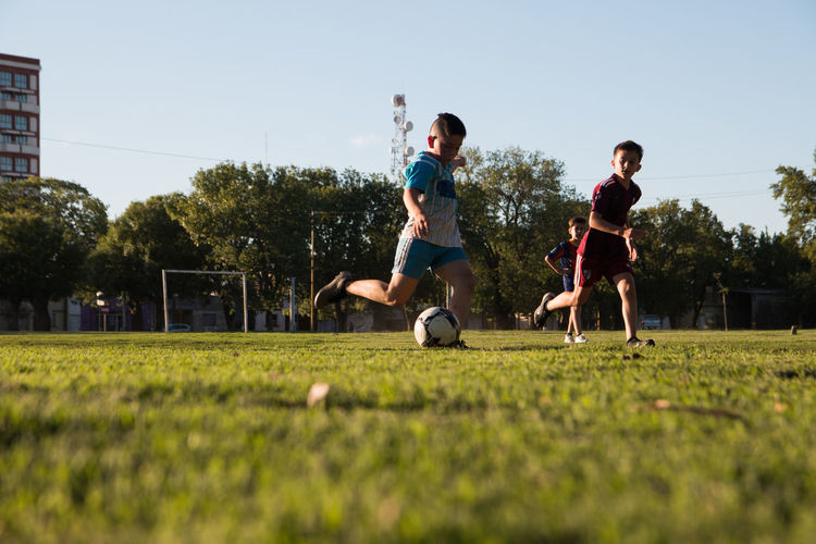 Children playing soccer outdoors field