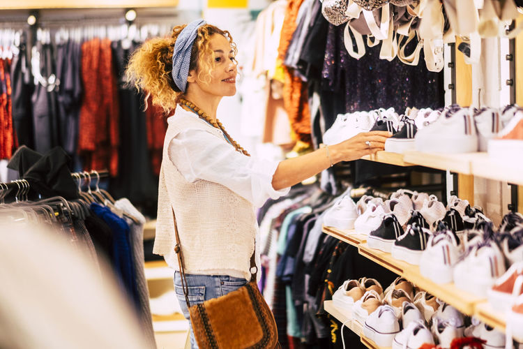 Smiling woman shopping at clothing store