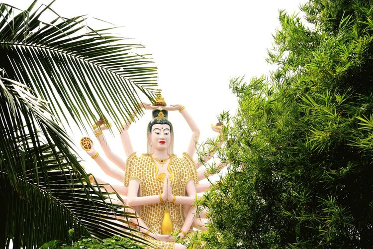 Low Angle View Of Guanyin Statue At Wat Plai Laem Temple