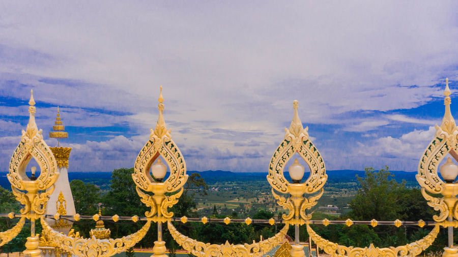 Fence on the Great Pagoda at Wat Chedi Yai Chai Mongkol Roi Et, Thailand Fence On The Great Pagoda Architecture Belief Building Building Exterior Built Structure Cloud - Sky Day Gold Colored Nature No People Outdoors Place Of Worship Religion Sky Spirituality Travel Travel Destinations