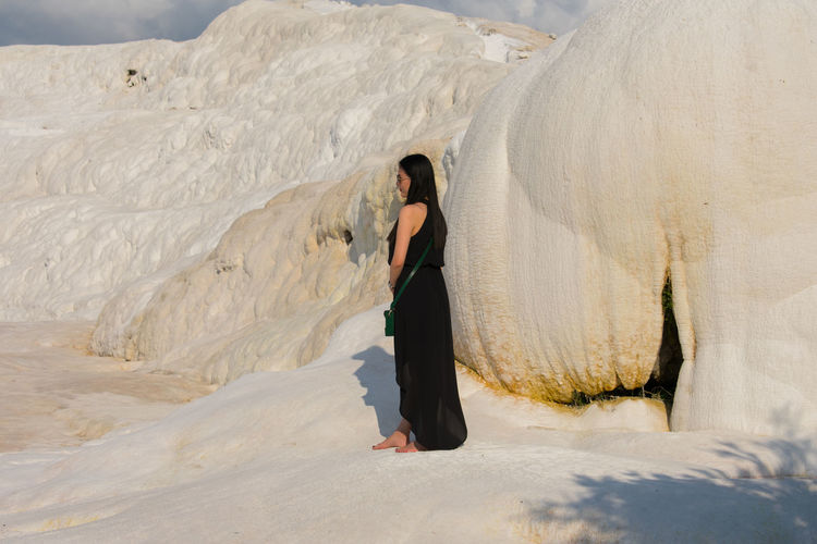 Woman standing on snow