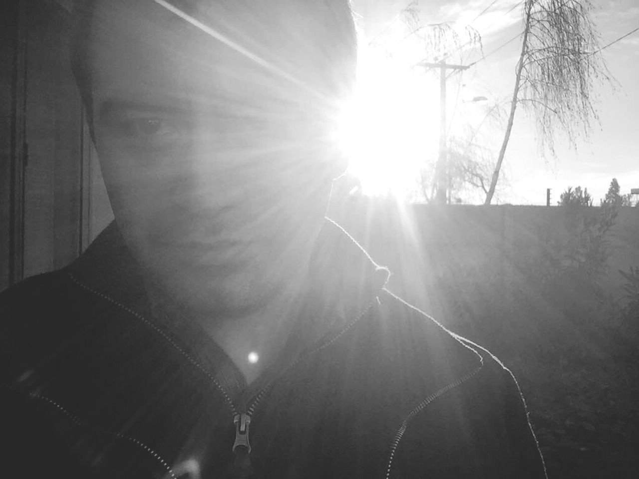 sun, lens flare, sunbeam, one person, sunlight, men, real people, outdoors, tree, nature, day, one man only, close-up, sky, adult, people