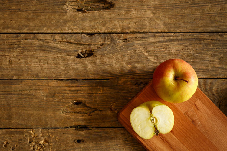High angle view of apple on cutting board