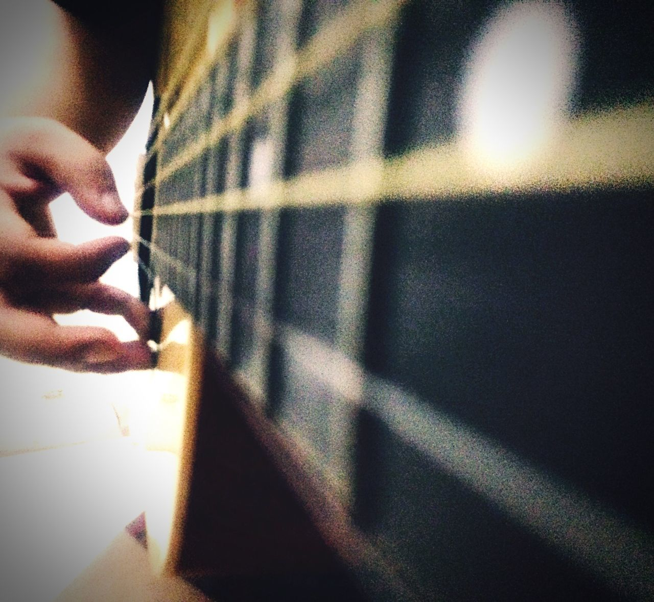 human hand, indoors, music, human body part, real people, one person, human finger, musical instrument, playing, arts culture and entertainment, close-up, musical instrument string, guitar, fretboard, day, people