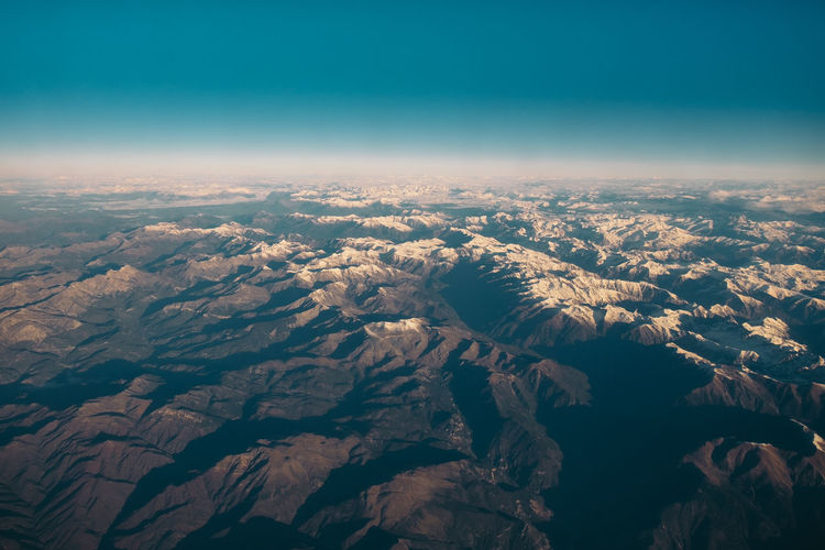Mountains seen from plane Plane View Aerial View Arid Climate Landscape Nature Sky Tranquility Travel Destinations