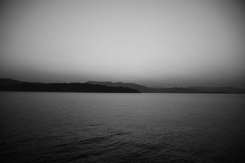 Tranquility Sea Scenics No People Tranquil Scene 瀬戸内海 Silhouette Nature Outdoors Mountain Beauty In Nature Landscape Blackandwhite Sky Day Monochrome Connected By Travel Lost In The Landscape EyeEmNewHere 세계 Nikonphotography Photogenic  Snap View Beauty In Nature Black And White Friday