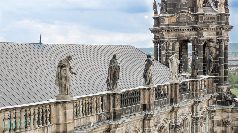 High Section Of Statues Atop Cathedral Roof