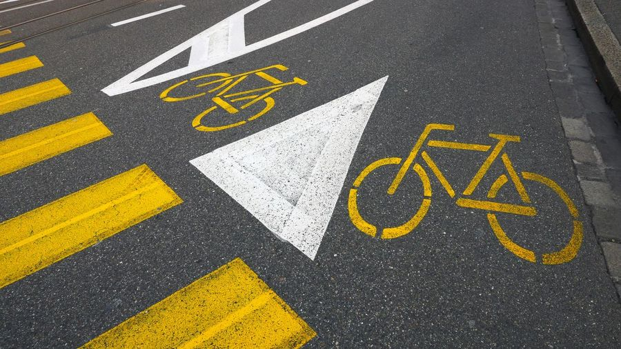 High angle view of bicycle parking signs on street