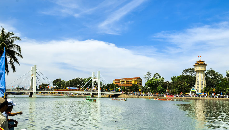 Spring boat racing in Ca Ty river Architecture Beauty In Nature Blue Built Structure Ca Ty River Cloud Cloud - Sky Cloudy Day Idyllic Nature No People Outdoors Phan Thiet Rippled Scenics Sky Tourism Tranquil Scene Tranquility Travel Destinations Tree Water