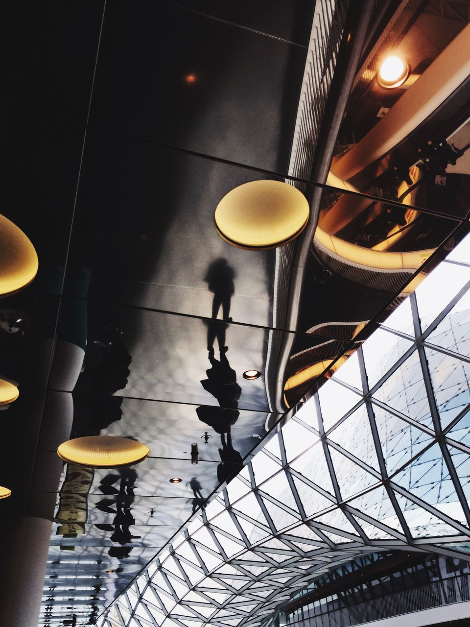 indoors, ceiling, illuminated, real people, architecture, one person, day, people