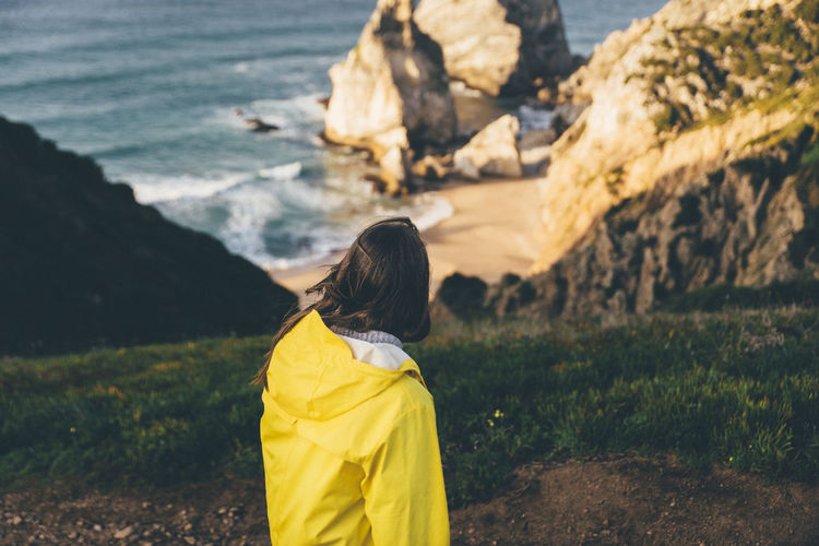 Enjoying The View Ocean View Portugal Praia Praia Da Ursa Quiet Moments Quietness The Great Outdoors - 2018 EyeEm Awards Winter Beach Beauty In Nature Europe Landscape Looking At View Nature Ocean Outdoor Photography Outdoors Praiadaursa Roadtrip Sea Water Waves Yellow Yellow Raincoat EyeEmNewHere