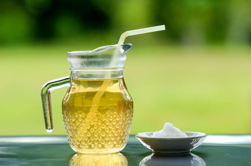 Close-up Container Crockery Drink Drinking Straw Focus On Foreground Food Food And Drink Freshness Glass Glass - Material Healthy Eating Household Equipment Kitchen Utensil No People Non-alcoholic Beverage Refreshment Still Life Straw Table Tea Tea - Hot Drink Transparent