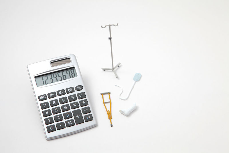 Accident Bandage Caculator Clinic Copy Space Crutches Gibbs Hospital Hospitalization Illness InFusion Injury Insurance Insured Medical Medical Care Miniature Money Nurse Patient Sickness Studio Shot Treatment White Background Wounds