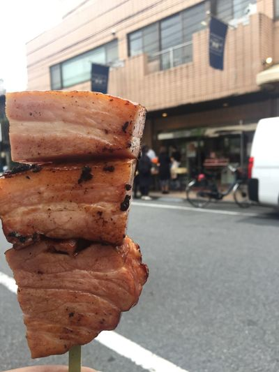 Close-up of food on sidewalk in city