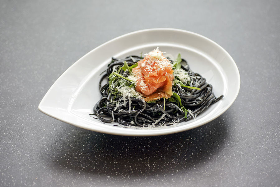 Squid Ink Pasta with Smoked Salmon Smoked Salmon  Squid Ink Pasta Bowl Close-up Day Food Food And Drink Freshness Garnish Gourmet Gray Background Healthy Eating High Angle View Indoors  Meal No People Pasta Plate Ready-to-eat Salmon Serving Size Still Life Studio Shot