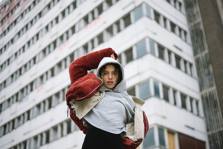 laura. Brutalism Woman Building Exterior Architecture City Standing Day Built Structure Front View Focus On Foreground One Person Waist Up Young Adult Women Lifestyles Portrait Building Outdoors Child Young Women City Life Warm Clothing Scarf Teenager International Women's Day 2019