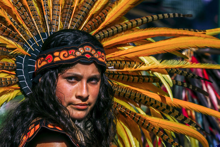 An Aztec dancer shares tradition and culture at Chicano Park in the San Diego, California community of Barrio Logan at a public park event gathering on February 3rd, 2018 Immigration Mexican American Adult Adults Only Aztec Azteca Beautiful Woman Close-up Diverse Usa Heritage Immigration Reform Latina Latino Mexican Multi Colored One Person One Woman Only One Young Woman Only People Real People Rise U.s Latina Usa Latina Young Adult Young Women