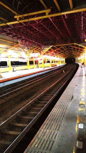 Railroad Track Transportation Railroad Station Public TransportationTrain Station My Point Of View Cityscapes Railway Station Railroad Tracks Streamzoofamily No People Commuter Rail Transportation Night Travel Architecture Vanashing Point Yellow Building Exterior The City Light