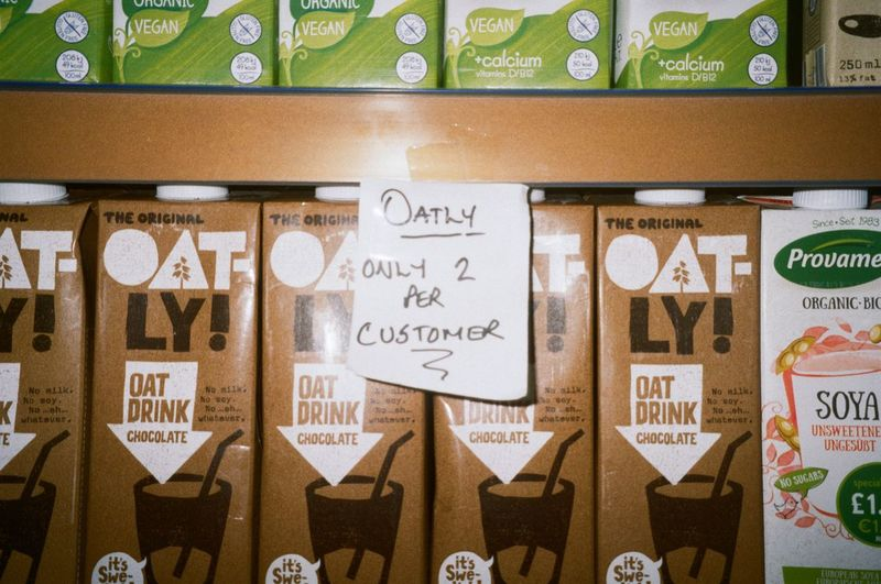 State of emergency Analogue Photography 35mm Oat Milk Text Communication No People Western Script Business Day Wall - Building Feature Food And Drink Retail