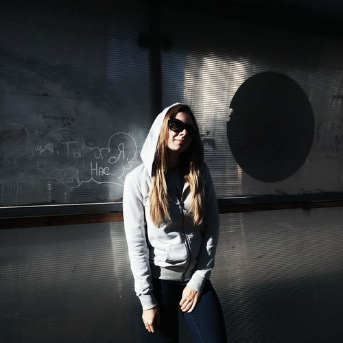 TakeoverContrast Indoors  Standing Young Women Young Adult Full Length Casual Clothing Front View Person Looking At Camera Long Hair Fashionable Dark Tunnel