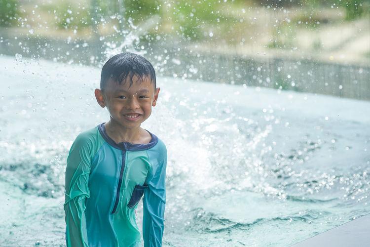 Portrait of boy in swimming pool