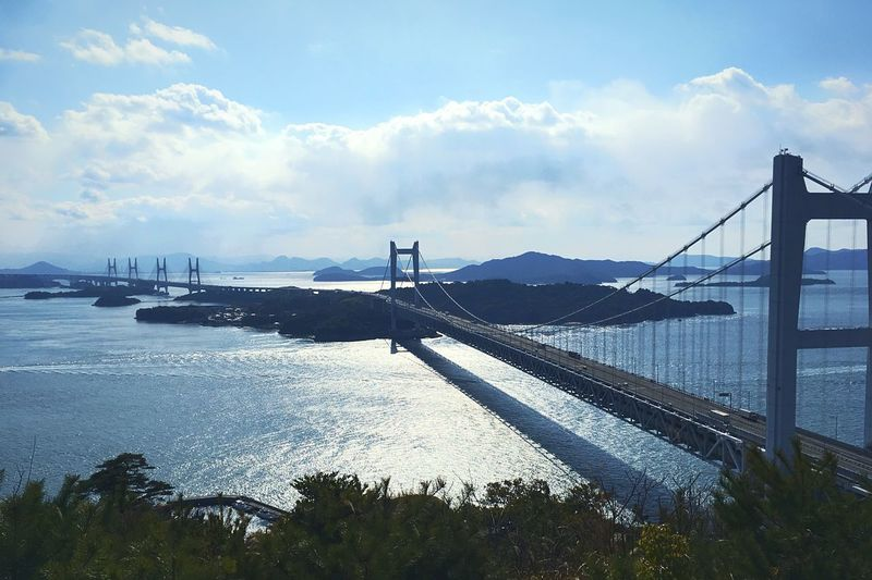 Seascape Sea And Sky Sea Seto Inland Sea 瀬戸内海 Bridge - Man Made Structure Sky Connection Suspension Bridge Built Structure Architecture Cloud - Sky Travel Destinations Travel Beauty In Nature Water