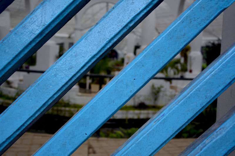 Close-Up Of Blue Wooden Grate