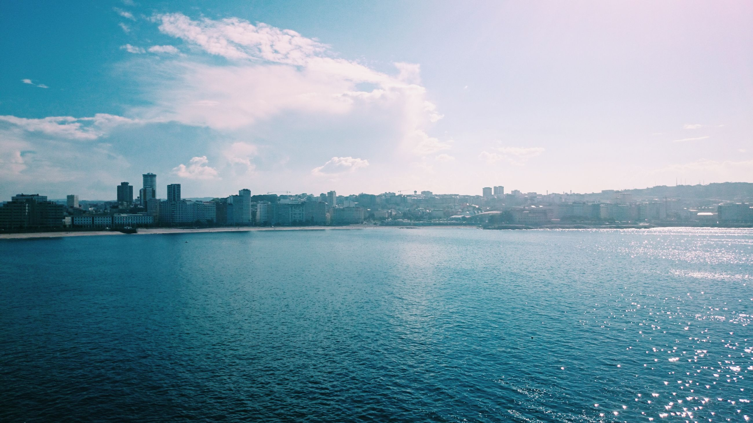 waterfront, water, building exterior, architecture, built structure, sky, sea, rippled, city, river, cityscape, scenics, tranquility, tranquil scene, blue, nature, cloud, cloud - sky, no people, beauty in nature