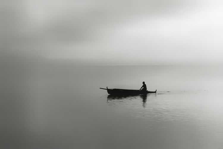 Silhouette Of Person In A Boat In Sea