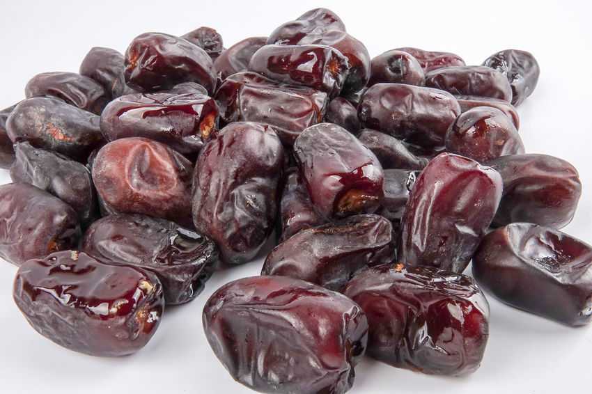Date fruits on white background. Selective focus. Dinner Time Iftar Ramadan Mubarak Anti Oxidant Close-up Dates Fruit Food Food And Drink Freshness Healthy Eating Indoors  Kurma No People Still Life Wellbeing