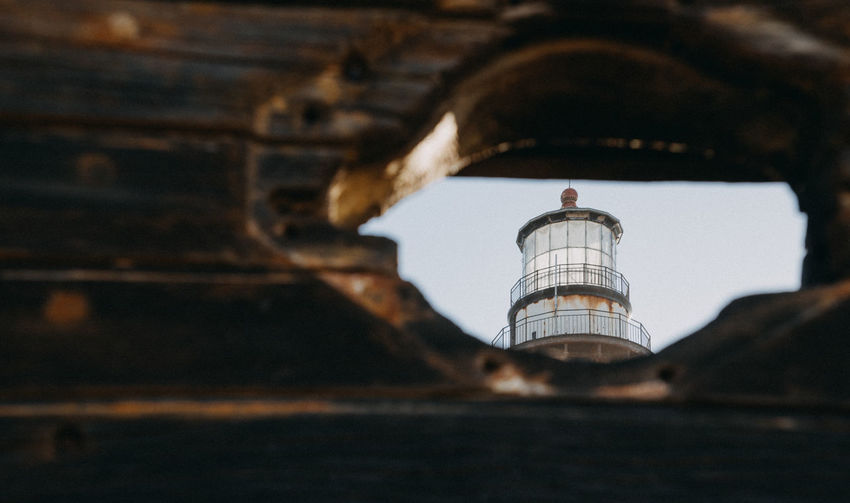 Lighthouse Old Lighthouse Looking Through An Object Architecture Built Structure Tower Building Exterior Sky Building Day Outdoors No People Nature Wood Selective Focus Low Angle View History Old California California Coast