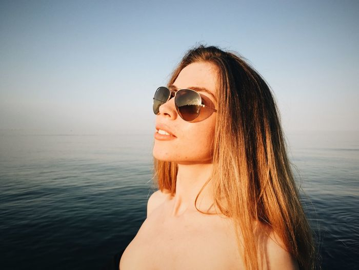 Black Sea Blonde Blonde Girl Blonde Hair Casual Clothing Fashion Fashion Photography Girl Golden Hour Golden Hour In Action Leisure Activity Lifestyles Model Poses Sea Smile Summer Summertime Sunglasses Sweamwear